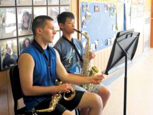 Herricks High School Class of 2016 graduate Andrew Jacobsen works with Jeremy Wong in a one-on-one music lesson as part of the Herricks Public Schools' Summer Music Program.